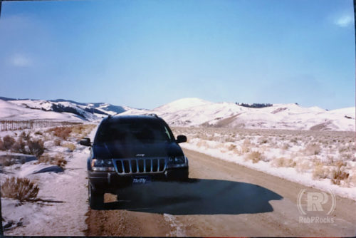 Jeep on lonely snowy road