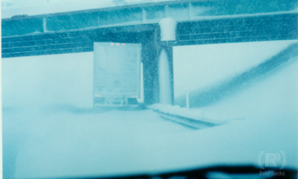 truck under overpass in snow
